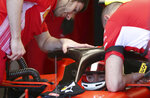 Ferrari driver Charles Leclerc of Monaco, bottom, prepares for the final practice session for the Australian Grand Prix in Melbourne, Australia, Saturday, March 16, 2019. The first race of the year is Sunday. (AP Photo/Rick Rycroft)