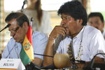 Bolivia's President Evo Morales attends a meeting where leaders of several South American nations that share the Amazon have gathered, in Leticia, on Colombia's Amazon river border with Brazil and Peru, Friday, Sept. 6, 2019. Presidents and representatives from several countries in South America's Amazon region met to discuss a joint strategy for preserving the world's largest rain forest, which has been under threat from a record number of wildfires.(AP Photo/Fernando Vergara)