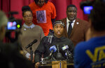 Stevante Clark, the brother of Stephon Clark who was killed by police last year, speaks during a news conference at the Genesis Church in Sacramento, Calif., Sunday, March 3, 2019. Standing behind Clark are National Action Network representative Margaret Fortune, left, Clark's uncle Curtis Gordon, and Tecoy Porter Sr., pastor at the Genesis Church. Clark's comments followed Saturday's announcement by Sacramento District Attorney Anne Marie Schubert that the two officers who shot and killed Stephon Clark will not be charged in the shooting. (AP Photo/Randall Benton)