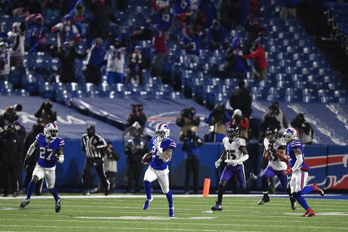 Buffalo Bills cornerback Taron Johnson (24) runs back an interception for a touchdown during the second half of an NFL divisional round football game against the Baltimore Ravens Saturday, Jan. 16, 2021, in Orchard Park, N.Y. (AP Photo/Adrian Kraus)