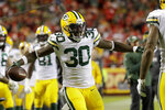 Green Bay Packers running back Jamaal Williams (30) celebrates with tight end Marcedes Lewis (89) after he scored a touchdown off a throw by quarterback Aaron Rodgers during the second half of an NFL football game against the Kansas City Chiefs in Kansas City, Mo., Sunday, Oct. 27, 2019. (AP Photo/Charlie Riedel)
