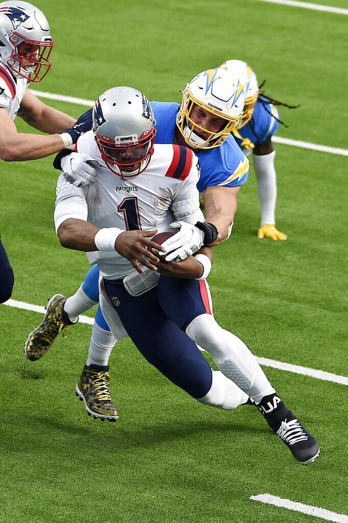 New England Patriots quarterback Cam Newton (1) is tackled by Los Angeles Chargers defensive end Joey Bosa during the first half of an NFL football game Sunday, Dec. 6, 2020, in Inglewood, Calif. (AP Photo/Kelvin Kuo)