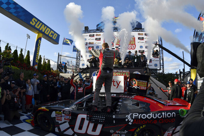 Driver Cole Custer car (#00) throws water in the winners circle during the  NASCAR Xfinity Series auto race, Saturday, Oct. 5, 2019, in Dover, Del. (AP Photo/Brien Aho)