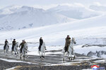 This undated photo provided on Wednesday, Dec. 4, 2019, by the North Korean government shows North Korean leader Kim Jong Un, right, and his wife Ri Sol Ju, second from right, riding on white horse during a visit to Mount Paektu, North Korea. North Korea says leader Kim has taken a second ride on a white horse to a sacred mountain in less than two months. Independent journalists were not given access to cover the event depicted in this image distributed by the North Korean government. The content of this image is as provided and cannot be independently verified. Korean language watermark on image as provided by source reads: