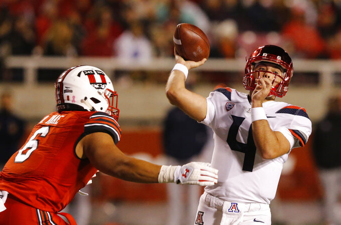 Arizona quarterback Rhett Rodriguez (4) throws a pass as Utah defensive end Bradlee Anae (6) closes in during the second half of an NCAA college football game Friday, Oct. 12, 2018, in Salt Lake City. (AP Photo/Rick Bowmer)