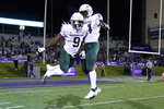 Michigan State running back Kenneth Walker III, left, celebrates with running back Elijah Collins after scoring a touchdown against Northwestern during the first half of an NCAA college football game in Evanston, Ill., Friday, Sept. 3, 2021. (AP Photo/Nam Y. Huh)