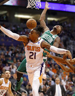 Boston Celtics guard Marcus Smart is fouled by Phoenix Suns forward Richaun Holmes (21) during the first half of an NBA basketball game Thursday, Nov. 8, 2018, in Phoenix. (AP Photo/Matt York)