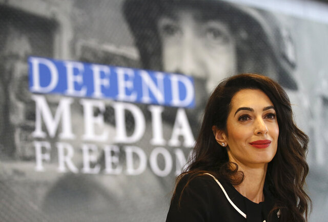 "FILE - In this Friday, April 5, 2019 file photo, International human rights lawyer Amal Clooney smiles during a Foreign Ministers G7 meeting in Dinard, Brittany. Clooney has become the highest profile lawyer to quit over her opposition to the British government's suggestion that it could break international law in the event it fails to agree a trade deal with the European Union. In a letter Friday, Sept. 18, 2020 to British Foreign Secretary Dominic Raab, the human rights lawyer said she is quitting her role as the U.K.'s special envoy on media freedom over the government's ""lamentable"" suggestion. (AP Photo/David Vincent, file)"