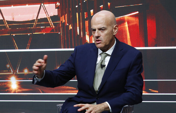 Eni CEO Claudio Descalzi talks with journalists during a press conference at the 2019-22 ENI strategy presentation in San Donato Milanese, Milan, Italy, Friday, March 15, 2019. Italian energy giant ENI says it will increase oil and gas production by 3.5 percent a year over its new 2019-2022 business plan, in line with the prior four years. (AP Photo/Antonio Calanni)