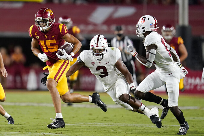 Southern California wide receiver Drake London (15) runs past Stanford linebacker Levani Damuni (3) during the first half of an NCAA college football game Saturday, Sept. 11, 2021, in Los Angeles. (AP Photo/Marcio Jose Sanchez)