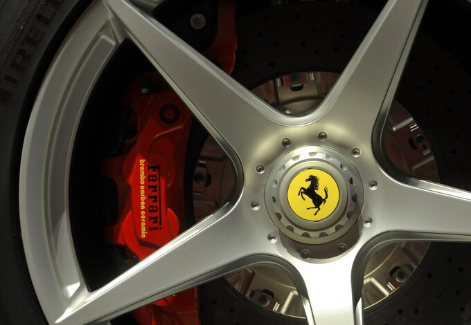FILE - In this Wednesday, May 8, 2013 file photo a Ferrari logo is displayed on a wheel in the department Ferrari factory in Maranello, Italy. Luxury sports carmaker Ferrari has tapped Benedetto Vigna, an Italian executive at Europe's largest semiconductor chipmaker, as its new CEO, the company announced Wednesday, June 9, 2021. (AP Photo/Marco Vasini, File)
