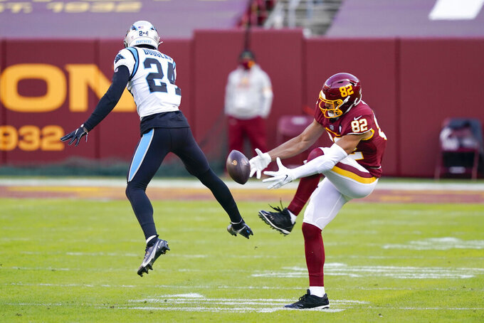 Washington Football Team tight end Logan Thomas (82) drops a pass as Carolina Panthers cornerback Rasul Douglas (24) cover him during the first half of an NFL football game, Sunday, Dec. 27, 2020, in Landover, Md. (AP Photo/Susan Walsh)