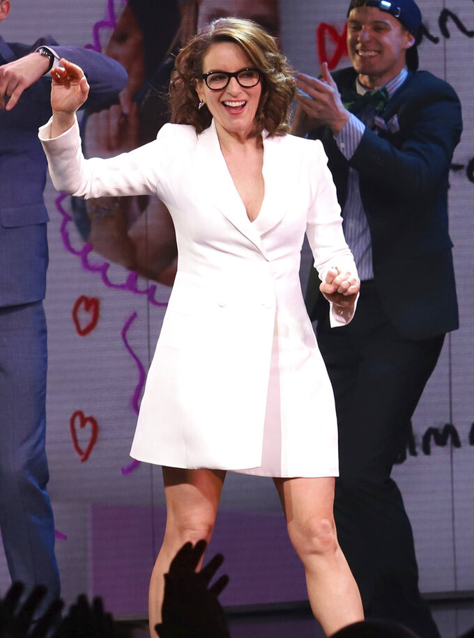 """FILE- Tina Fey participates in the curtain call for the """"Mean Girls"""" opening night on Broadway at the August Wilson Theatre on April 8, 2018, in New York. Producers of the musical, based on Tina Fey's hit film, have decided not to reopen when authorities allow theaters to open in New York City, the second and likely not last established show casualty of COVID-19 on the Great White Way. (Photo by Greg Allen/Invision/AP, File)"""