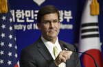 U.S. Defense Secretary Mark Esper attends a joint press conference with South Korean Defense Minister Jeong Kyeong-doo, after the 51st Security Consultative Meeting (SCM) at the Defense Ministry in Seoul Friday, Nov. 15, 2019. U.S. Defense Secretary Esper says South Korea is wealthy enough to pay a bigger share of the cost of having U.S. troops on its soil. (Jung Yeon-je/Pool Photo via AP)
