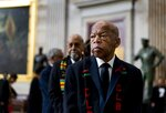 FILE - In this Oct. 24, 2019 file photo, Rep. John Lewis, D-Ga., prepares to pay his respects to Rep. Elijah Cummings, D-Md., who lies in state during a memorial service at the U.S. Capitol Hill in Washington. The NAACP is honoring Lewis for his Congressional service and long history as a civil rights activist. (Melina Mara/The Washington Post via AP, Pool, File)