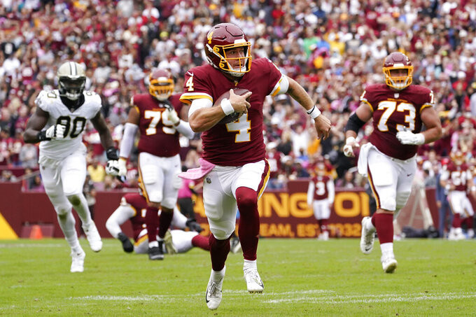 Washington Football Team quarterback Taylor Heinicke (4) rushes the ball in the first half of an NFL football game against the New Orleans Saints, Sunday, Oct. 10, 2021, in Landover, Md. (AP Photo/Alex Brandon)