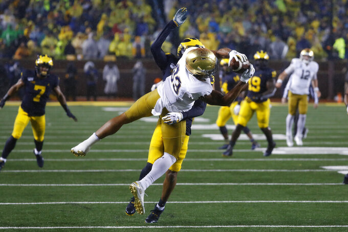 Notre Dame wide receiver Chase Claypool (83) catches a pass as Michigan defensive back Vincent Gray (31) defends in the first half of an NCAA college football game in Ann Arbor, Mich., Saturday, Oct. 26, 2019. (AP Photo/Paul Sancya)