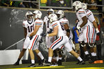 Arizona tight end Bryce Wolma (81) celebrates his touchdown with his teammates during the first quarter of an NCAA college football game Saturday, Sept. 25, 2021, in Eugene, Ore. (AP Photo/Andy Nelson)