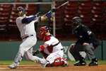 New York Yankees' Gary Sanchez follows through on a solo home run in front of Boston Red Sox catcher Christian Vazquez during the ninth inning of a baseball game Friday, Sept. 18, 2020, in Boston. (AP Photo/Michael Dwyer)
