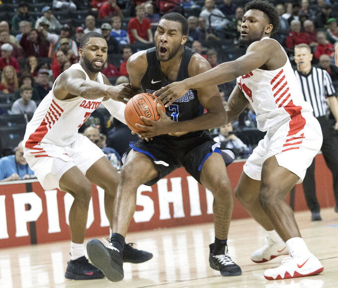 Dayton guard Trey Landers, left, and guard Jordan Davis, right, defend against Saint Louis guard Javon Bess (3) during the second half of an NCAA college basketball game in the Atlantic 10 Conference tournament, Friday, March 15, 2019, in New York. (AP Photo/Mary Altaffer)