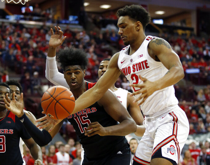 Ohio State guard Musa Jallow, right, works for a rebound against Rutgers forward Myles Johnson during the first half of an NCAA college basketball game in Columbus, Ohio, Saturday, Feb. 2, 2019. (AP Photo/Paul Vernon)
