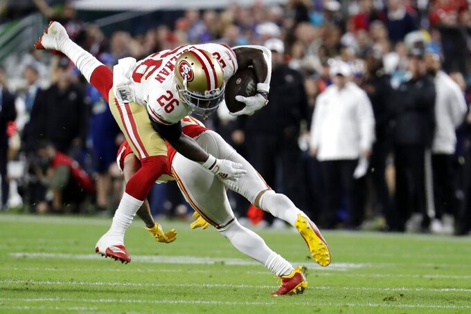 San Francisco 49ers' Tevin Coleman (26) runs against the Kansas City Chiefs during the first half of the NFL Super Bowl 54 football game Sunday, Feb. 2, 2020, in Miami Gardens, Fla. (AP Photo/Lynne Sladky)