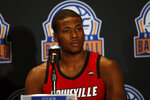 Louisville basketball player Steven Enoch considers a question during the Atlantic Coast Conference NCAA college basketball media day in Charlotte, N.C., Tuesday, Oct. 8, 2019. (AP Photo/Nell Redmond)