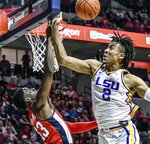 LSU forward Trendon Watford (2) blocks a shot by Mississippi guard Bryce Williams (13) during an NCAA college basketball game in Oxford, Miss., Saturday, Jan. 18, 2020. (Bruce Newman/The Oxford Eagle via AP)