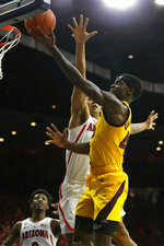 Arizona State forward Zylan Cheatham, right, drives past Arizona center Chase Jeter, left, in the first half during an NCAA college basketball game, Saturday, March 9, 2019, in Tucson, Ariz. (AP Photo/Rick Scuteri)
