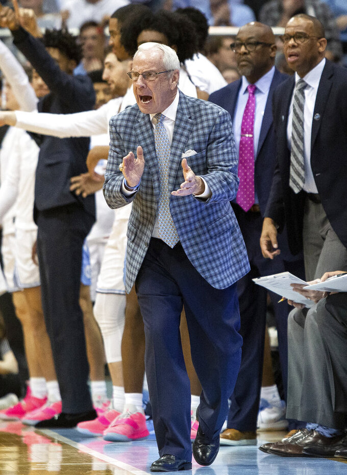North Carolina coach Roy Williams reacts to a play during the second half of the team's NCAA college basketball game against Syracuse in Chapel Hill, N.C., Tuesday, Feb. 26, 2019. (AP Photo/Ben McKeown)