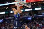Dallas Mavericks forward Dwight Powell (7) slam dunks over New Orleans Pelicans guard Frank Jackson in the first half of an NBA basketball game in New Orleans, Tuesday, Dec. 3, 2019. (AP Photo/Gerald Herbert)