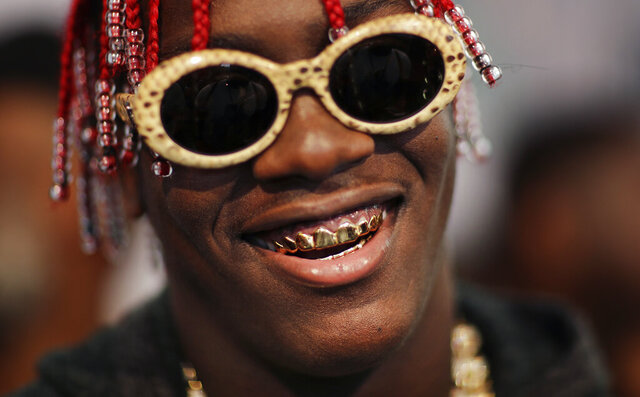FILE - In this Sept. 17, 2016, file photo, Lil Yachty arrives on the red carpet for the BET Hip-Hop Awards in Atlanta. Georgia State Patrol arrested rapper Lil Yachty this month after he was allegedly caught driving more than 150 mph on an Atlanta highway. State Patrol said troopers pulled over a white Ferrari with the 23-year-old behind the wheel on Sept. 21. (AP Photo/David Goldman, File)