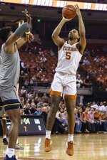 Texas' Royce Hamm (5) goes to shoot against West Virginia during an NCAA college basketball game in Austin, Texas, Monday, Feb. 24, 2020. (Lola Gomez/Austin American-Statesman via AP)