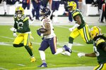 Chicago Bears' David Montgomery runs during the first half of an NFL football game against the Green Bay Packers Sunday, Nov. 29, 2020, in Green Bay, Wis. (AP Photo/Mike Roemer)