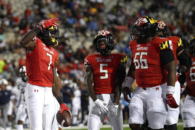 Maryland wide receiver Dontay Demus Jr. (7) celebrates his touchdown with wide receiver Rakim Jarrett (5) and offensive lineman Aric Harris (66) during the first half of an NCAA college football game against Howard, Saturday, Sept. 11, 2021, in College Park, Md. (AP Photo/Nick Wass)