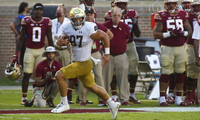 Notre Dame tight end Michael Mayer (87) runs past the Florida State sideline for a touchdown in the first quarter of an NCAA college football game Sunday, Sept. 5, 2021, in Tallahassee, Fla. (AP Photo/Phil Sears)