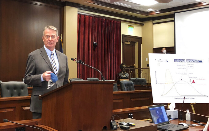 FILE - In this Monday, Oct. 26, 2020, file photo, Gov. Brad Little speaks during a news conference in the Statehouse in Boise, Idaho, as he ordered a return to some restrictions to slow the spread of the coronavirus. A pair of bills nearing final approval in 2021 would prohibit the Republican governor from declaring an emergency for more than 60 days without legislative approval. (AP Photo/Keith Ridler)