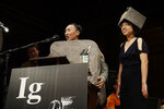 David Hu speaks as Patricia Yang, right, listens as they receive the Ig Nobel award in physics for studying how and why wombats make cubed poo, at the 29th annual Ig Nobel awards ceremony at Harvard University, Thursday, Sept. 12, 2019, in Cambridge, Mass. The spoof prizes for weird and sometimes head-scratching scientific achievement are bestowed by the Annals of Improbable Research magazine, and handed out by real Nobel laureates. (AP Photo/Elise Amendola)