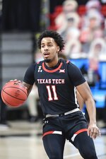 Texas Tech's Kyler Edwards (11) dribbles the ball down the court during the first half of an NCAA college basketball game against Baylor in Lubbock, Texas, Saturday, Jan. 16, 2021. (AP Photo/Justin Rex)