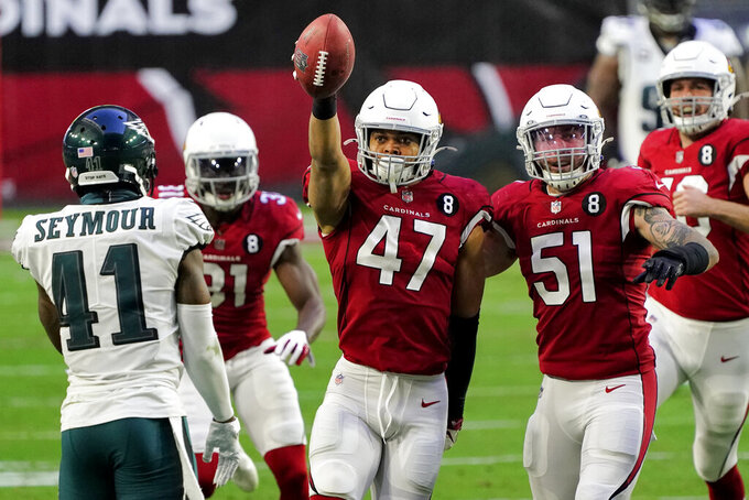 Arizona Cardinals linebacker Zeke Turner (47) celebrates his interception with linebacker Tanner Vallejo (51) as =p41= looks on during the second half of an NFL football game, Sunday, Dec. 20, 2020, in Glendale, Ariz. (AP Photo/Rick Scuteri)