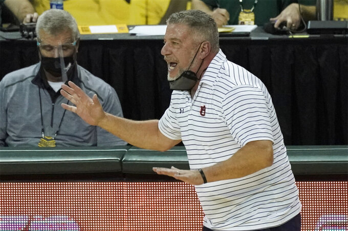 Auburn head coach Bruce Pearl directs his team against Baylor during the first half of an NCAA college basketball game in Waco, Texas, Saturday, Jan. 30, 2021. (AP Photo/Chuck Burton)