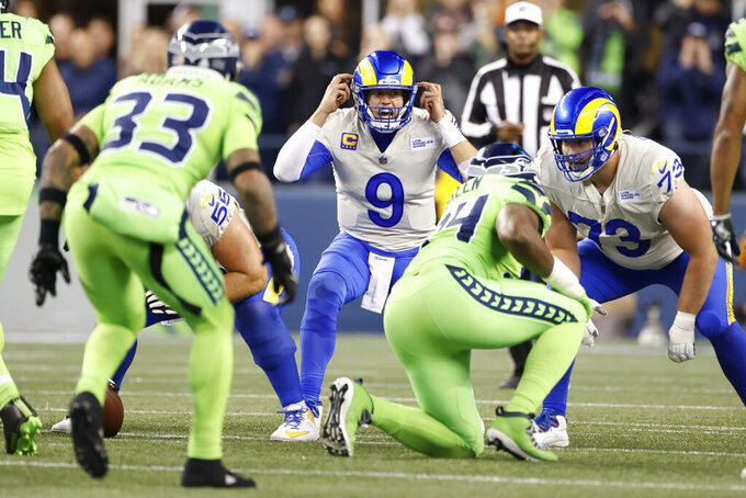 Los Angeles Rams quarterback Matthew Stafford calls from the line of scrimmage during the second half of an NFL football game against the Seattle Seahawks, Thursday, Oct. 7, 2021, in Seattle. The Rams won 26-17. (AP Photo/Craig Mitchelldyer)
