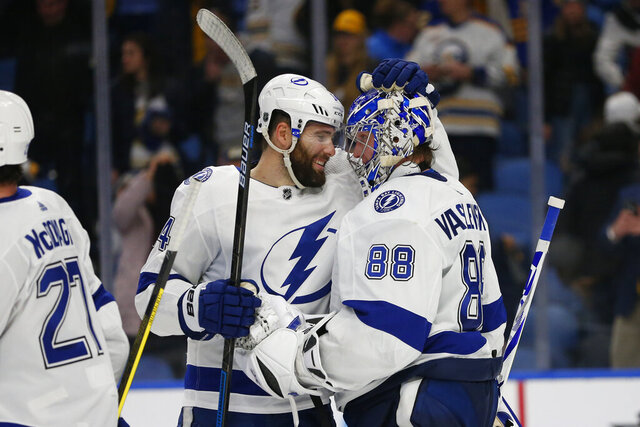 Tampa Bay Lightning forward Pat Maroon (14) and goalie Andrei Vasilevskiy (88) celebrate the team's 6-4 victory over the Buffalo Sabres in an NHL hockey game Tuesday, Dec. 31, 2019, in Buffalo, N.Y. (AP Photo/Jeffrey T. Barnes)