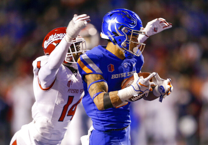Boise State wide receiver Khalil Shakir, right, with a 49 yard touchdown reception in front of Fresno State defensive back Jaron Bryant (14) in the fourth quarter of an NCAA college football game, Friday, Nov. 9, 2018, in Boise, Idaho. Boise State won 24-17 over Fresno State. (AP Photo/Steve Conner)