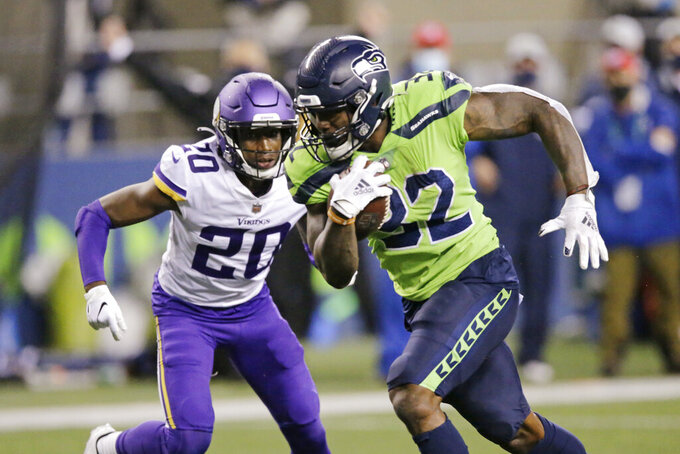 Seattle Seahawks' Chris Carson rushes for a touchdown as Minnesota Vikings' Jeff Gladney gives chase during the second half of an NFL football game, Sunday, Oct. 11, 2020, in Seattle. (AP Photo/John Froschauer)