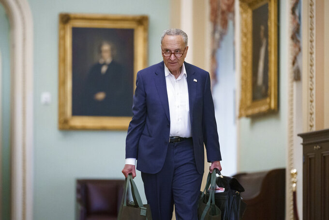Senate Majority Leader Chuck Schumer, D-N.Y., arrives at the Capitol in Washington, Monday, July 12, 2021. Congressional Democrats and immigration advocates are staring at their best chance in years to overcome Republican opposition and give millions of people in the U.S. without legal authorization a way to become citizens. (AP Photo/J. Scott Applewhite)