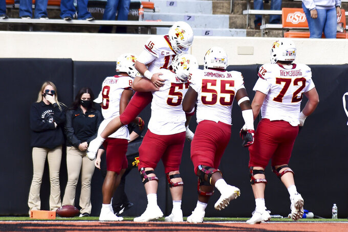 Iowa State quarterback Brock Purdy (15) celebrates with  teammates after scoring a touchdown against Oklahoma State during an NCAA college football game Saturday, Oct. 24, 2020, in Stillwater, Okla. (AP Photo/Brody Schmidt)