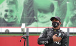 Mercedes driver Lewis Hamilton of Britain after his record breaking 92nd win at the Formula One Portuguese Grand Prix at the Algarve International Circuit in Portimao, Portugal, Sunday, Oct. 25, 2020. (Jose Sena Goulao, Pool via AP)