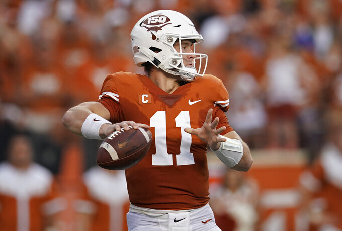Texas's Sam Ehlinger (11) looks to pass against the Kansas during the first half of an NCAA college football game in Austin, Texas, Saturday, Oct. 19, 2019. (AP Photo/Chuck Burton)