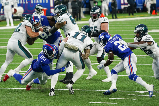 New York Giants' Trent Harris (93) and Jabrill Peppers (21) sack Philadelphia Eagles' Carson Wentz (11) during the second half of an NFL football game Sunday, Nov. 15, 2020, in East Rutherford, N.J. (AP Photo/Seth Wenig)